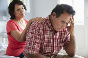 Wife Comforting Senior Husband Suffering With Dementia