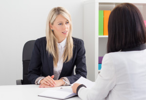 Young confident business woman in job interview
